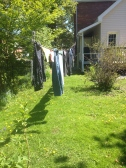 Clothes hanging on line in the sun.