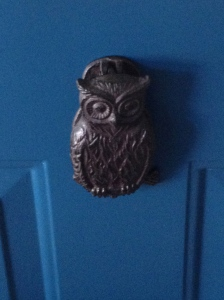 Pretty blue door, complete with owly door knocker.