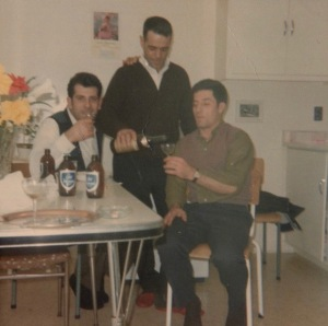 Serving alcohol - as he always did when there were guests