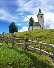 A Slovenian church at the tip top of a mountain