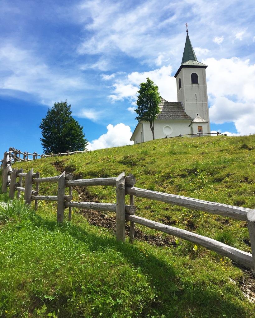 A Slovenian church at the tip top of a mountain