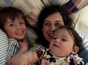 Me and my kids in a pile of laundry.